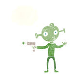Cartoon alien with ray gun with thought bubble Royalty Free Stock Photography