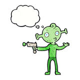 Cartoon alien with ray gun with thought bubble Royalty Free Stock Photos