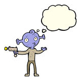 Cartoon alien with ray gun with thought bubble Royalty Free Stock Photo