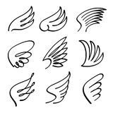Cartoon angel wings vector set. Sketch doodle winged abstract emblems isolated on white background Royalty Free Stock Image