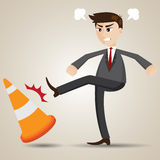 Cartoon angry businessman kicking cone Royalty Free Stock Photos
