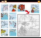 Cartoon animals jigsaw puzzle game. Cartoon Illustration of Education Jigsaw Puzzle Game for Preschool Children with Sea Life Animals or Fish Group Stock Photography