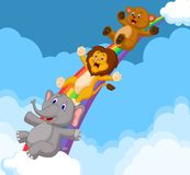 Cartoon Animals Sliding Down a Rainbow Royalty Free Stock Images