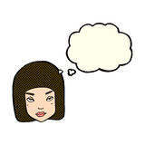 Cartoon annoyed female face with thought bubble Royalty Free Stock Photography