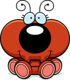 Cartoon Ant Sitting. A cartoon illustration of a little ant sitting and smiling Royalty Free Stock Photo