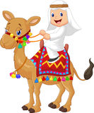 Cartoon Arab boy riding camel stock illustration