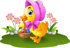 Cartoon baby duck carrying decorated egg Royalty Free Stock Photos