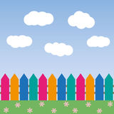 Cartoon background with color fence and clouds Royalty Free Stock Image