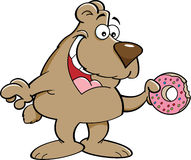 Cartoon bear eating a doughnut. Royalty Free Stock Photography