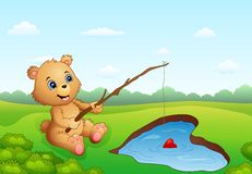Cartoon bear fishing in a heart-shaped Stock Images