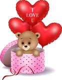 Cartoon bear in a gift box holding red shape balloon Stock Images