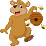 Cartoon bear holding bee Stock Images