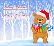 Cartoon bear holding gifts with winter background Royalty Free Stock Photography
