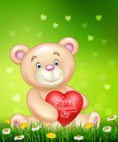 Cartoon bear holding red heart balloons on green grass Royalty Free Stock Image