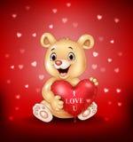 Cartoon bear holding red heart balloons Royalty Free Stock Photos