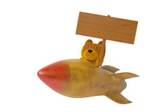 A cartoon bear holding a wooden sign on old rocket,3D illustration Stock Images