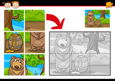 Cartoon bear jigsaw puzzle game Royalty Free Stock Images