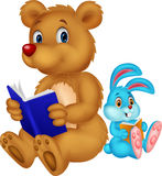 Cartoon bear and rabbit reading book Royalty Free Stock Images
