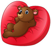 Cartoon bear relax on heart shaped bed Stock Image