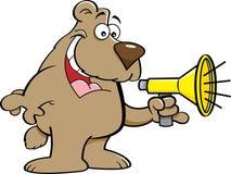 Cartoon bear talking into a megaphone. Royalty Free Stock Photography
