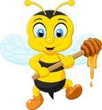 Cartoon bee holding honey Stock Photography