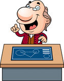 Cartoon Ben Franklin Blueprints. An illustration of a cartoon Ben Franklin with a desk and blueprints Stock Images