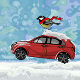 Cartoon bird fluttering scarf, sitting on a car hurtling on snow in winter. Cartoon bird fluttering scarf, sitting on a car on snow Stock Photo