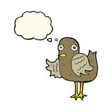 Cartoon bird waving wing with thought bubble Stock Image