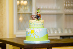 Cartoon birthday-cake. For a little boy Royalty Free Stock Image