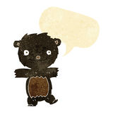 cartoon black bear cub with speech bubble Royalty Free Stock Photos