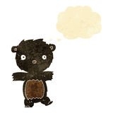 cartoon black bear cub with thought bubble Royalty Free Stock Image