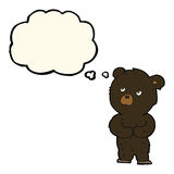 cartoon black bear cub with thought bubble Stock Photo