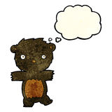 cartoon black bear cub with thought bubble Stock Images