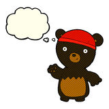 Cartoon black bear wearing hat with thought bubble Stock Photography