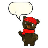 Cartoon black bear in winter hat and scarf with speech bubble Stock Image