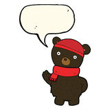 Cartoon black bear in winter hat and scarf with speech bubble Royalty Free Stock Photo