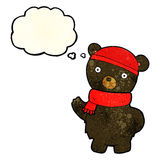 Cartoon black bear in winter hat and scarf with thought bubble Royalty Free Stock Photography