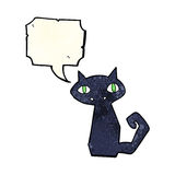 Cartoon black cat with speech bubble Stock Photo
