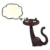 Cartoon black cat with thought bubble Stock Images