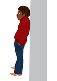 Cartoon black man in red sweater standing near the wall Stock Photos