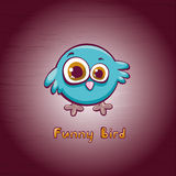 Cartoon blue bird. Funny cartoon blue bird with big eyes on a pink background Stock Photo