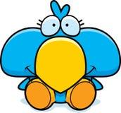 Cartoon Blue Bird Sitting. A cartoon illustration of a little blue bird sitting and smiling Stock Images