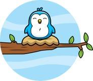 Cartoon Blue Bird. A cartoon blue bird sitting in a nest in a tree Royalty Free Stock Image