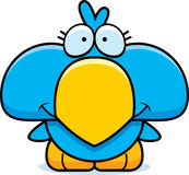 Cartoon Blue Bird Smiling. A cartoon illustration of a little blue bird happy and smiling Royalty Free Stock Photo