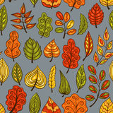 Cartoon blue hand-drawn seamless pattern with autumn leaves Stock Photo