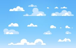 Cartoon Blue sky with clouds on the shiny day. Silhouette of white fluffy clouds isolated on blue background. Vector set. Cartoon Blue sky with clouds on the Stock Photo