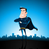 Cartoon Blue Superhero. Illustration of a cartoon superhero standing with cityscape behind Stock Photos