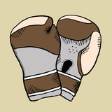 Cartoon boxing glove. Vintage boxing glove isolated on brown Royalty Free Stock Image