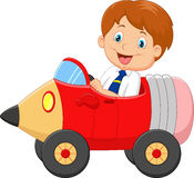 Cartoon boy driving a pencil car Stock Photos
