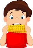 Cartoon boy eating corn Royalty Free Stock Images